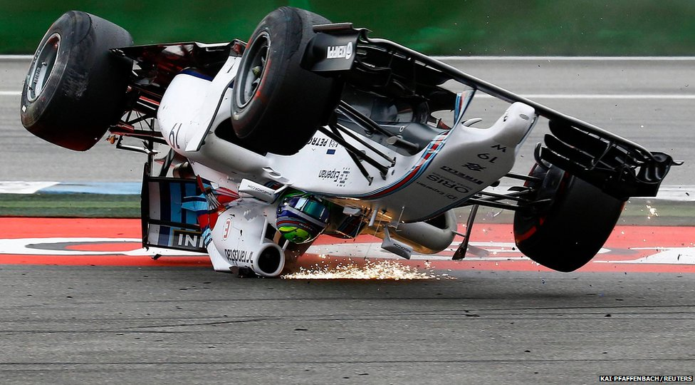 Williams Formula One driver Felipe Massa of Brazil crashes with his car in the first corner after the start of the German F1 Grand Prix at the Hockenheim