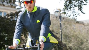 Cyclist wearing suit
