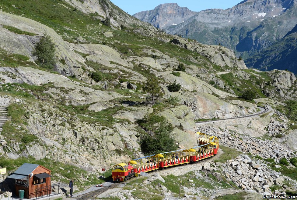 Visitors ride the little train of Artouste in the Pyrenees, Franc