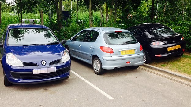 Cars parked on verge at Norfolk and Norwich University Hospital