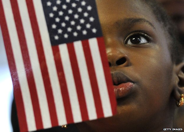 Child with flag at US naturalisation ceremony