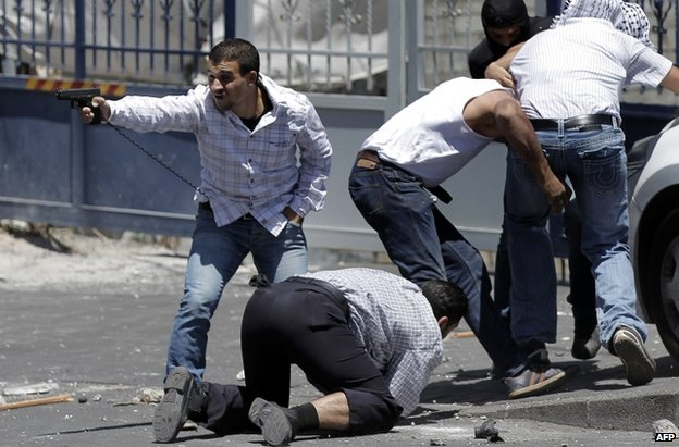 Israeli plainclothes police officers make an arrest after Friday Prayers in East Jerusalem, 25 July