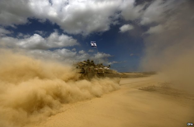 An Israeli troop carrier heads towards the Gaza Strip, 25 July