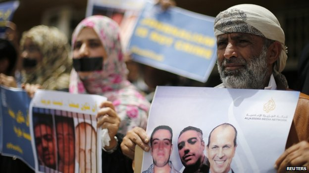 Journalists protest against the imprisonment of Al-Jazeera journalists Peter Greste, Mohamed Fahmy and Baher Mohamed outside Al Jazeera's offices in Sanaa (June 2014)