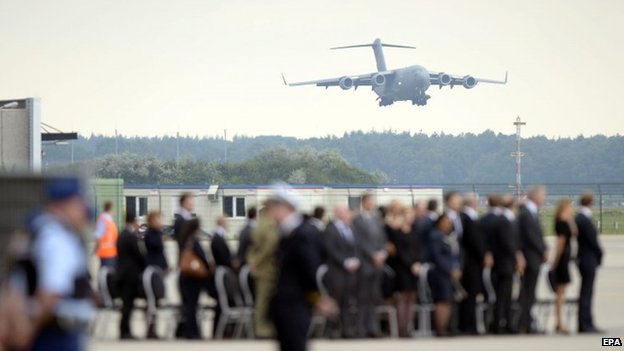 A Boeing C17 of the Royal Australian Airforce carrying 45 coffins with remains of the victims of the MH17 plane crash arrives at Eindhoven military airport, Netherlands (July 25 2014)