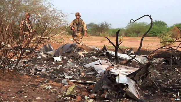 French soldiers inspect the wreckage of the Air Algerie flight AH5017 at the crash site in Mali - 25 July 2014