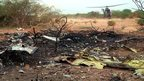 A helicopter lands at the site of the Air Algerie flight AH5017 crash in Mali - July 25, 2014