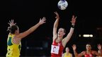 Wales' netball team were beaten 63-26 by Australia in their opening game in Glasgow.