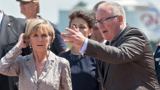 Dutch Foreign Minister Frans Timmermans (right) and his Australian counterpart Julie Bishop attend a ceremony at Kharkiv airport on Friday during which coffins containing the remains of MH17 victims were flown to Holland