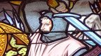 Stained glass of man with sword