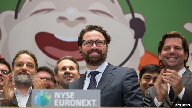 Mikkel Svane (centre) at the New York Stock Exchange after the firm's successful float back in May