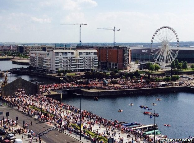 Crowds gathering at the Albert Dock to see Grandmother Giant