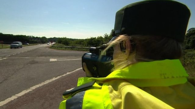 Policewoman with speed camera gun