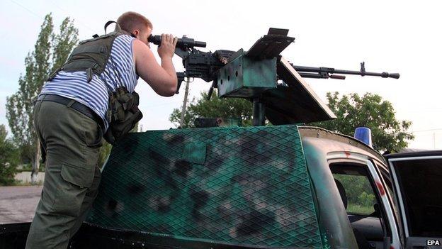 Pro-Russian rebel at checkpoint near Donetsk, 24 Jul 14