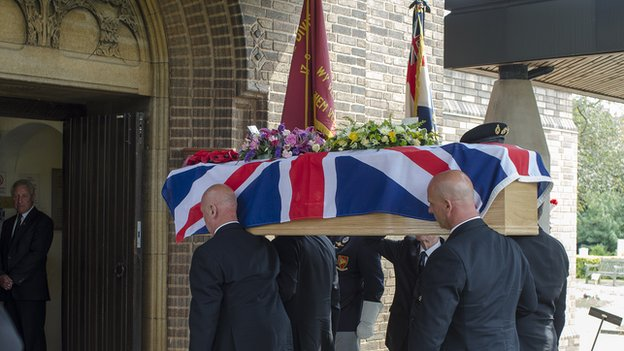 George Dexter's coffin, draped in a Union Jack