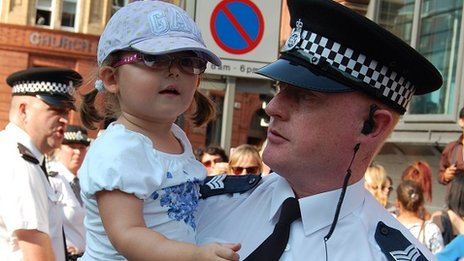 Police officer and little girl