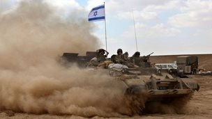 An Israeli flag on an armoured vehicle carrying Israeli troops to the border with Gaza - 25 July 2014