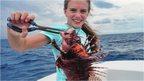 Lauren Arrington holding up a fish