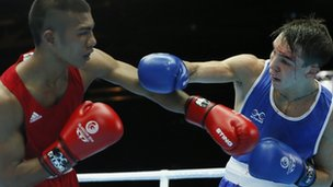 Michael Conlan of Northern Ireland, left, fights Matthew Martin from Nauru