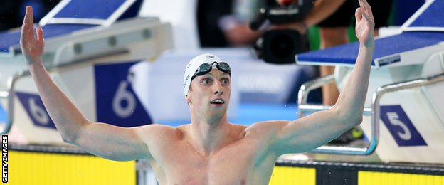 Scotland's Dan Wallace celebrates winning gold in the 400m individual medley at the Commonwealth Games.