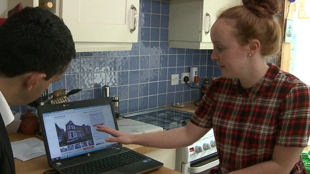 woman looks at property on laptop computer