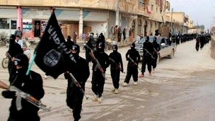 Undated file image posted on a militant website on 14 January 2014 shows fighters from Isis marching in Raqqa, Syria.