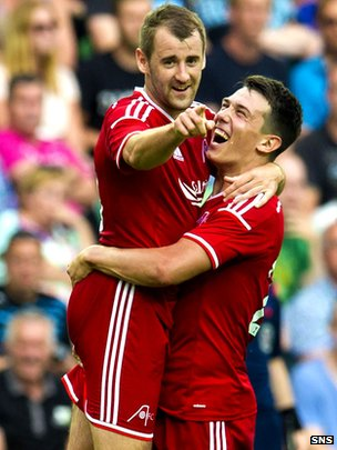 Niall McGinn celebrates his goal with Ryan Jack as Aberdeen beat Groningen 2-1