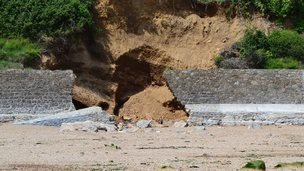 Breach in the Fermain Bay sea defences caused by storms in January