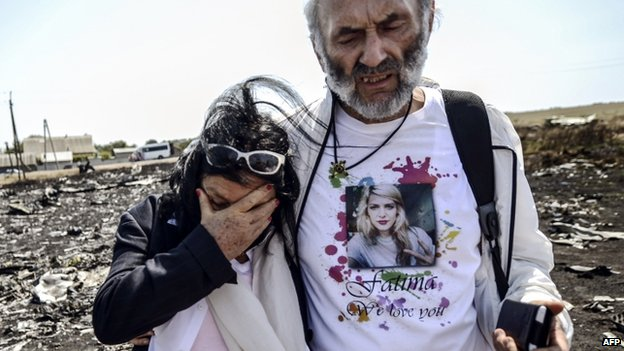 Angela Rudhart-Dyczynski and Jerzy Dyczynsk from Australia react as they arrive at the crash site to look for their late daughter Fatima