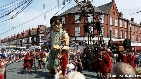 Children hitch a ride on Girl Giant