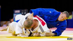 Scotland's Euan Burton defeats New Zealand's Jason Koster