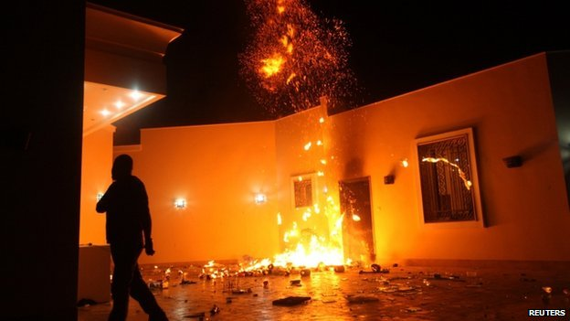 The US Consulate in Benghazi is seen in flames during a protest by an armed group said to have been protesting a film being produced in the US on 11 September 2012