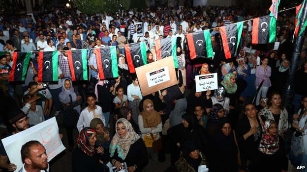 Libyans condemn and urge for an end of war during a protest at the Algeria Square on 26 July 2014 in Tripoli, Libya.