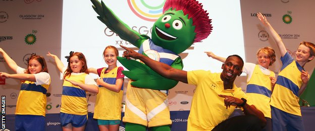 Bolt poses with Glasgow 2014 mascot Clyde