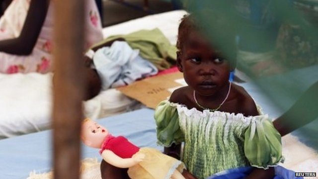 Child with doll in south sudan