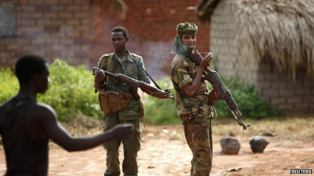 Seleka fighters stand in a village between Bambari and Grimari on 31 May 2014.