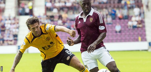 Hearts' Morgaro Gomis is challenged by Martin Mcniff of Annan