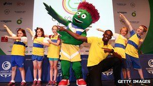 Usain Bolt meets children and the Glasgow 2014 mascot in Glasgow