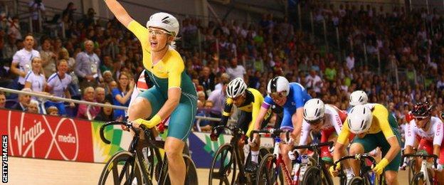 Annette Edmondson of Australia celebrates as she crosses the line to win gold in the Women's 10km Scratch