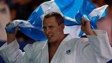 Euan Burton celebrates winning gold