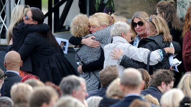 Friends and family pay their respects to Liam and Frankie Davison at a tribute service at Toorak College in Mount Eliza, Melbourne, Australia, 27 July, 2014.