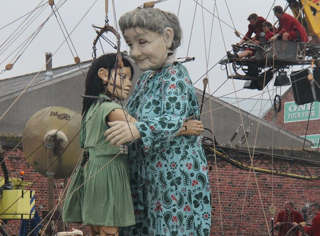 Little Girl Giant and the Grandma hugging