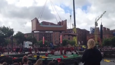 Giants being lowered onto the boat which took them away