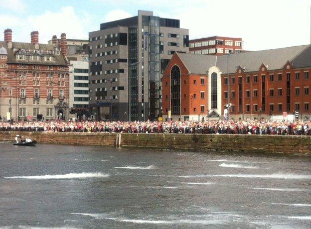 Crowds watching the Giants leave Liverpool