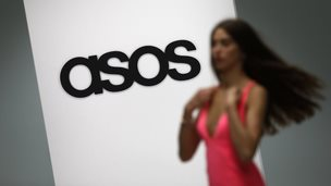 A model walks on an in-house catwalk at the Asos headquarters