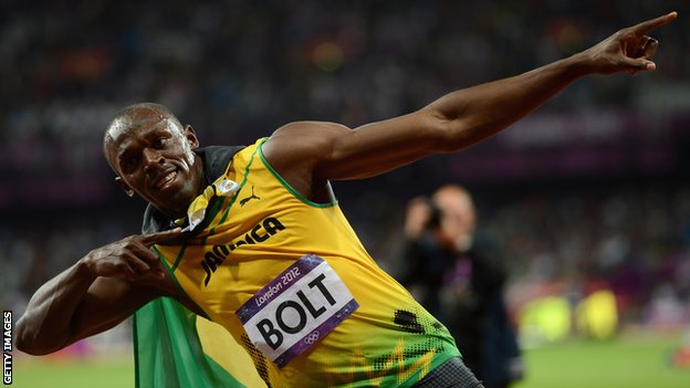 Usain Bolt doing his trademark lightning bolt celebration.