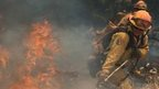 Fire fighter battles a spot fire near Plymouth, California (26 July 2014)