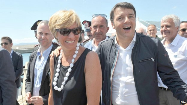 Italian Prime Minister Matteo Renzi (R) with Italian Defence Minister Roberta Pinotti (L) arrives at the site where the Costa Concordia is moored