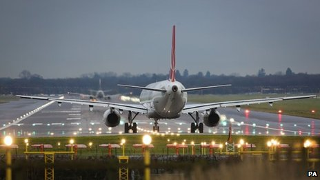 A passenger jet on the runway at Gatwick Airport