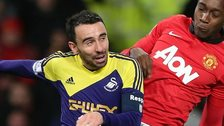 Swansea City's Leon Britton in action against Manchester United's Danny Wellbeck